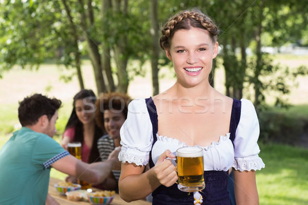 Pretty oktoberfest girl smiling at camera Stock photo © wavebreak_media