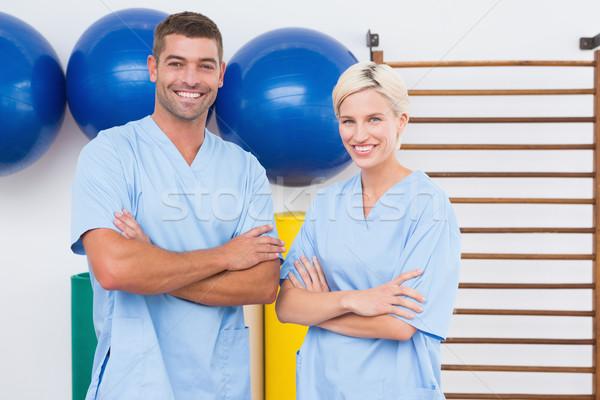 Equipo los brazos cruzados sonriendo cámara fitness estudio Foto stock © wavebreak_media