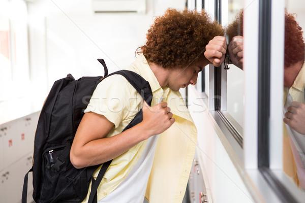 Fiatalember iroda folyosó oldalnézet áll férfi Stock fotó © wavebreak_media