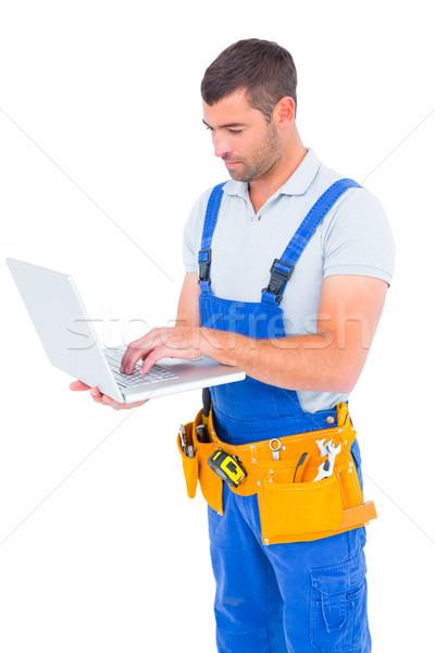 Timmerman Blauw met behulp van laptop mannelijke witte man Stockfoto © wavebreak_media