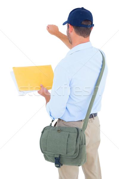 Postás levél fehér hátsó nézet férfi állás Stock fotó © wavebreak_media