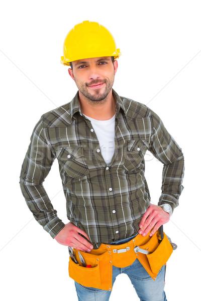 Handyman wearing tool belt with hands on hips Stock photo © wavebreak_media