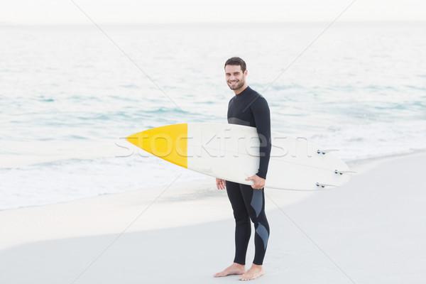 Férfi szörfdeszka napos idő tengerpart boldog sport Stock fotó © wavebreak_media