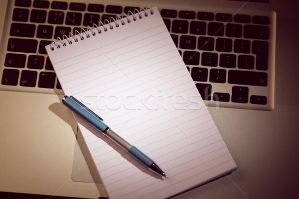 Notepad on laptop Stock photo © wavebreak_media