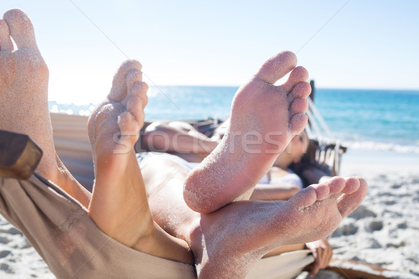 Stock photo: Happy couple napping together in the hammock