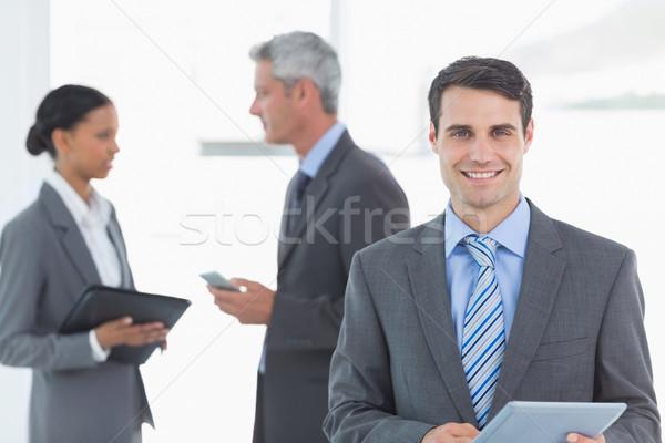 бизнесмен таблетка коллеги за служба портрет Сток-фото © wavebreak_media