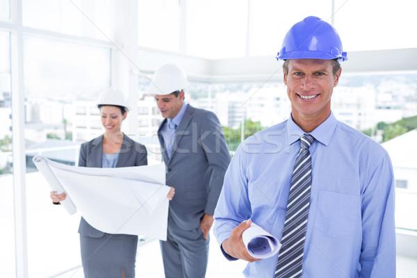 Zakenlieden vrouw hoeden blauwdruk kantoor Stockfoto © wavebreak_media