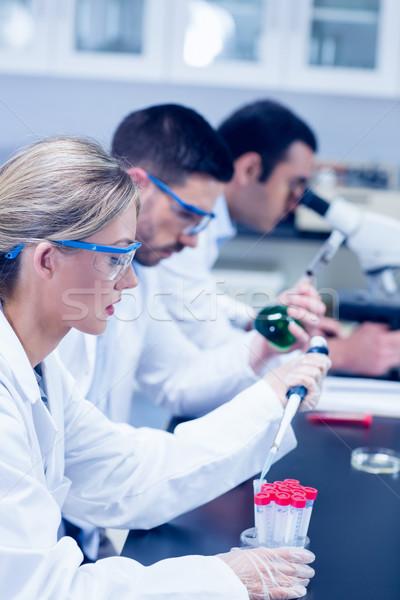ストックフォト: 科学 · 学生 · 作業 · 化学品 · ラボ · 大学
