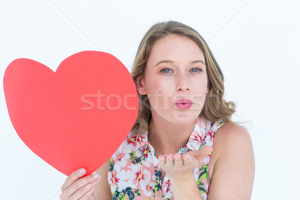 Nő tart szív kártya fúj csók Stock fotó © wavebreak_media