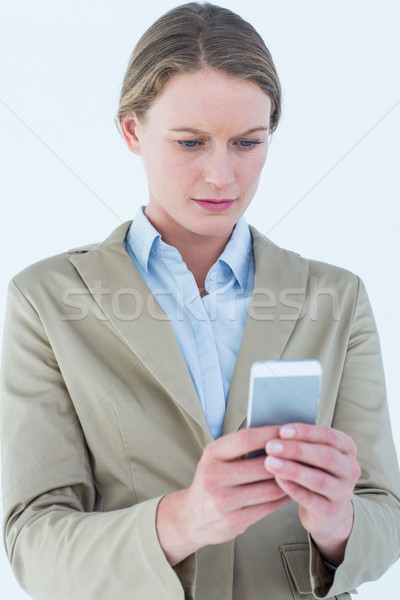 Stock photo: Businesswoman using her mobile phone