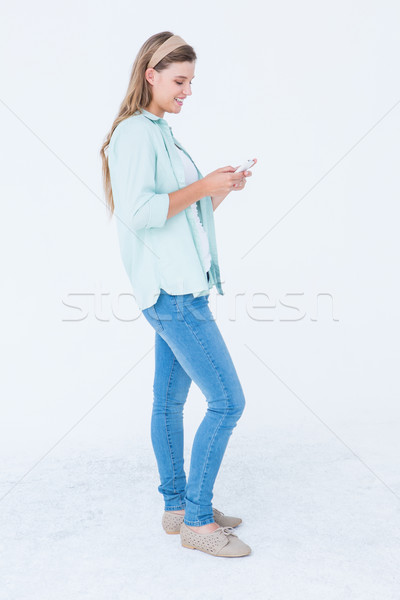 Pretty hipster using her smartphone  Stock photo © wavebreak_media