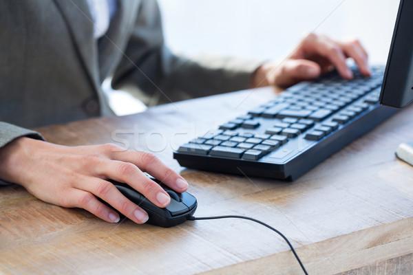 A businessman using his computer  Stock photo © wavebreak_media
