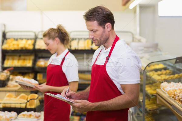 Widok z boku dwa piśmie notatnika piekarni żywności Zdjęcia stock © wavebreak_media