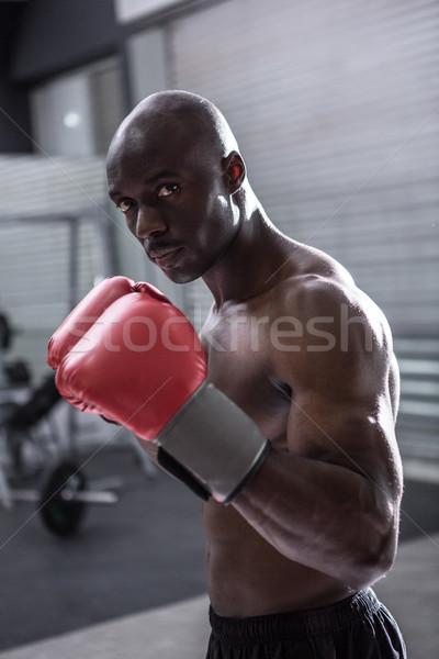 Young Bodybuilder posing in front of the camera Stock photo © wavebreak_media