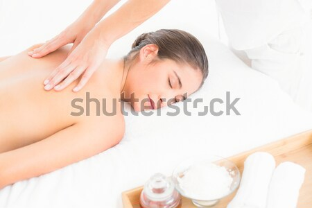 Stock photo: Attractive young woman receiving facial massage at spa center