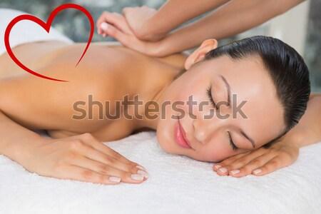 Beautiful woman receiving ear candle treatment at spa center Stock photo © wavebreak_media