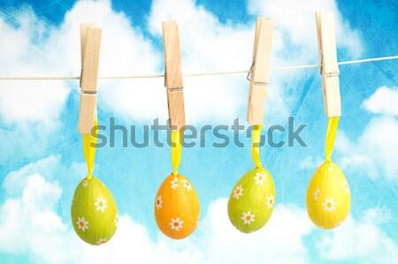 Easter Eggs on pegs in front of blue sky Stock photo © wavebreak_media
