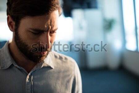 Chateado empresário olhando para baixo escritório vidro caderno Foto stock © wavebreak_media