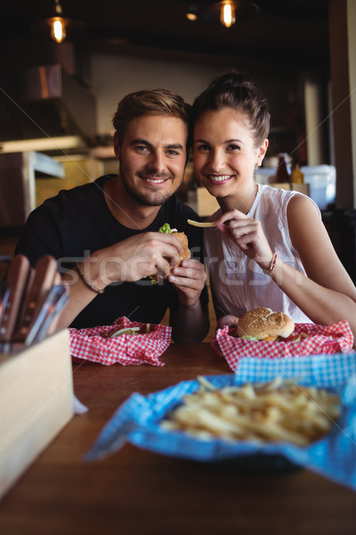 Portrait of happy couple having fast food Stock photo © wavebreak_media