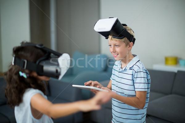 Stok fotoğraf: Kardeşler · sanal · gerçeklik · kulaklık · dijital · tablet