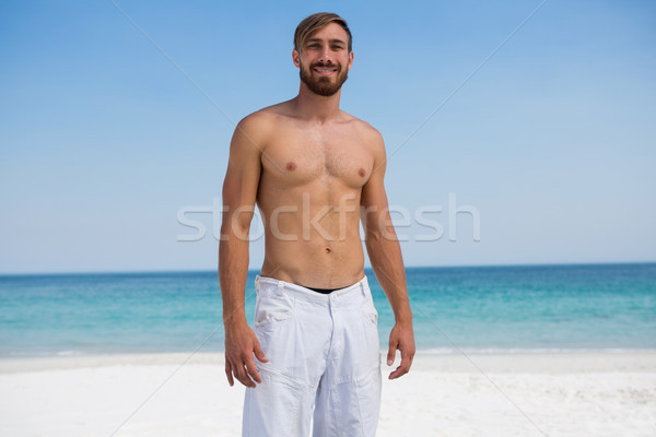 Stock photo: Portrait of smiling shirtless man at beach