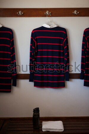 Rugby ball on bench against striped t-shirts Stock photo © wavebreak_media