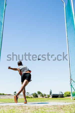 Rugby player kicking ball for goal against clear blue sky Stock photo © wavebreak_media