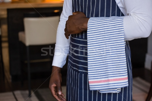 Mid section of waiter standing with towel Stock photo © wavebreak_media