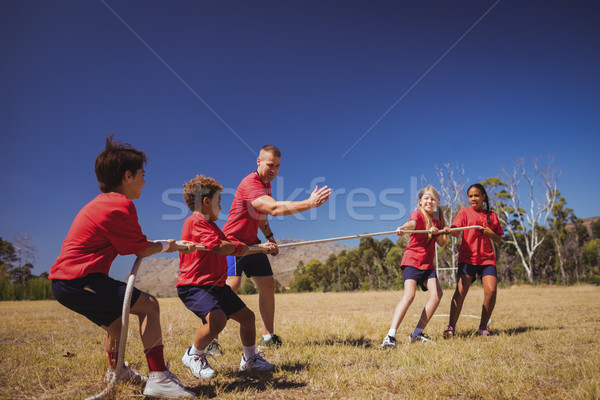 Kids playing tug of war during obstacle course training Stock photo © wavebreak_media