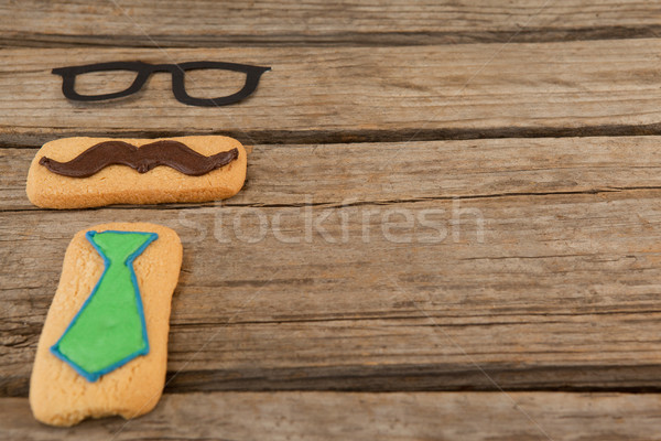 Cookies with mustache and necktie shape decorataion on wooden table Stock photo © wavebreak_media