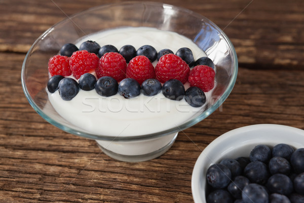 Fruit ice cream and blueberry on wooden table Stock photo © wavebreak_media