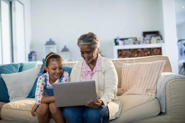 Grandmother and granddaughter using laptop in living room Stock photo © wavebreak_media
