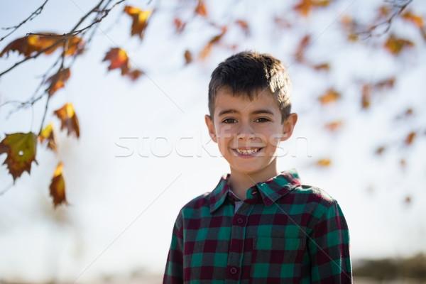 Sorridente menino em pé parque retrato Foto stock © wavebreak_media