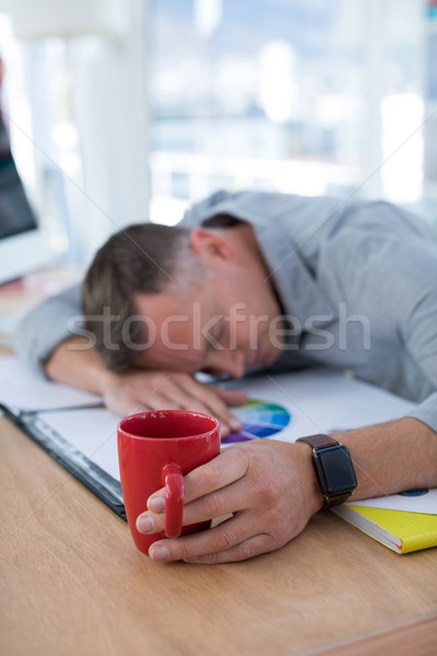 Tired male executive sleeping on desk Stock photo © wavebreak_media