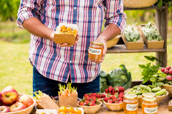 Midsection of man selling tomatoes and preserves Stock photo © wavebreak_media
