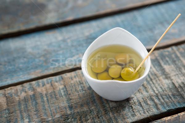 Marinált olajbogyók fa asztal étel gyümölcs zöld Stock fotó © wavebreak_media