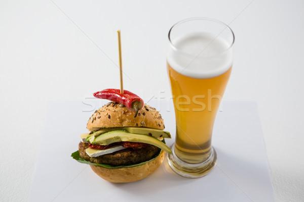 гамбургер халапеньо пива стекла белый таблице Сток-фото © wavebreak_media