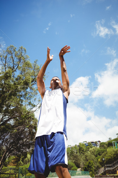 Low angle view of male teenager practicing basketball Stock photo © wavebreak_media