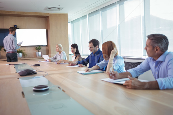 Stock photo: Business people at conference table in board room