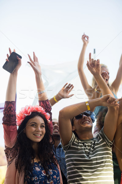 Happy fans with arms raised enjoying at music festival Stock photo © wavebreak_media