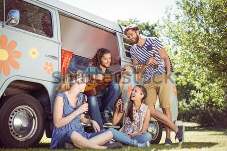 Portrait of smiling young friends at campsite Stock photo © wavebreak_media