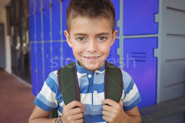Portrait of happy boy standing in corridor Stock photo © wavebreak_media