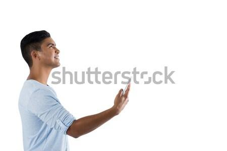Tizenéves fiú tart láthatatlan tárgy fehér tinédzser Stock fotó © wavebreak_media
