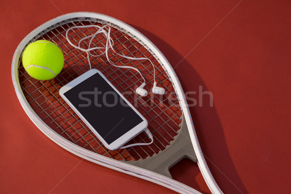 Mobiele telefoon hoofdtelefoon bal tennisracket Stockfoto © wavebreak_media