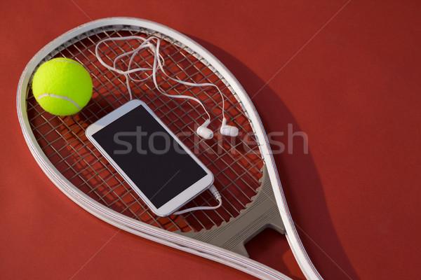Görmek cep telefonu kulaklık top tenis raketi Stok fotoğraf © wavebreak_media