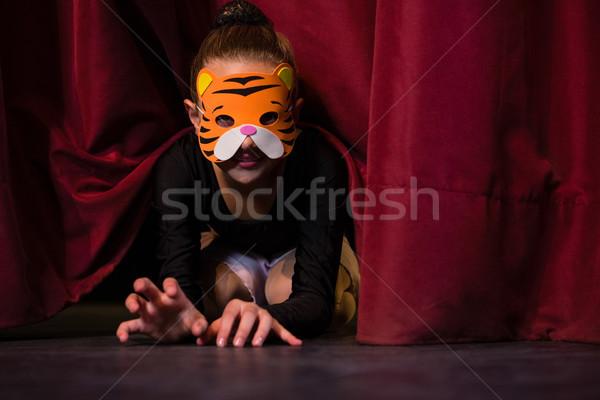 Ballet dancer wearing mask crawling through the stage curtain Stock photo © wavebreak_media