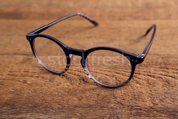 Close-up of spectacles on wooden table Stock photo © wavebreak_media