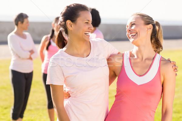 Stock fotó: Kettő · mosolyog · nők · visel · rózsaszín · mellrák