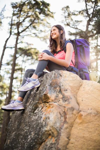 Genç mutlu jogging yapan oturma kaya Stok fotoğraf © wavebreak_media