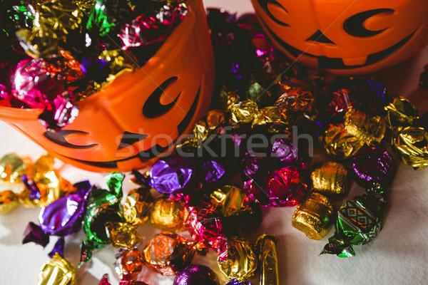 High angle view of orange buckets with colorful chocolates Stock photo © wavebreak_media